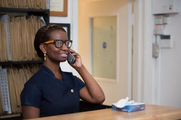 A health professional lady on the telephone wearing glasses