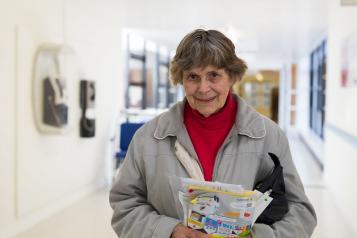 older lady with leaflets